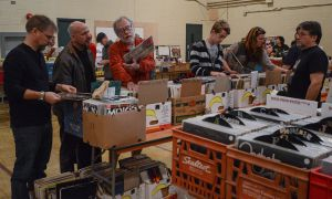 Record collectors and music lovers sift through the large collection in Mac-Brown Hall at the Kingston Record Show on Sunday.