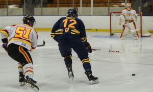 """Eric Ming's double overtime goal pushed the Gaels past the Guelph Gryphons in the """"Puck Cancer for Carley"""" game Friday night."""