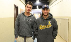 Defenceman Warren Steele (left) and forward Darcy Greenaway were teammates on the OHL's Kingston Frontenacs for three years before joining the Gaels this season.