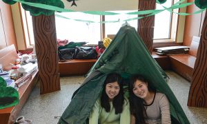 Rene Zou, left, and Yuzuki Saitoh are camping out in Stauffer Library to raise money for Room to Read.