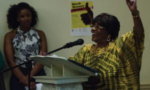 Judith Brown, president of the Kingston Afro-Caribe Association, gives a speech at the Black History Month opening ceremony.