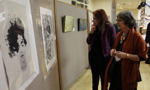 Guests admire the work on display at the event.