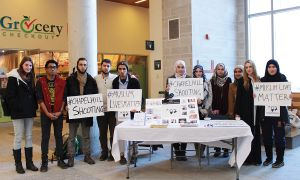 Reyhan Viceer, fifth from left, and members of QUMSA gathered in the ARC on Feb. 13 to support the victims of the shooting.