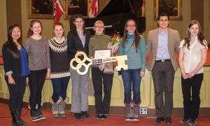 Danielle Aird, third from right, receives the Golden Key.