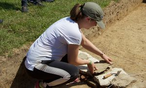 Meagher excavating a drain