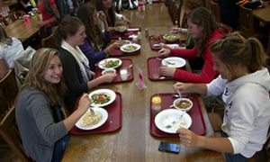 A group of girls seated in a cafeteria.