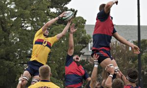 Trevor Helgason (top left) reaches for the ball during a lineout.