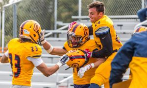 Matteo Del Brocco (middle) celebrates his 108 yard touchdown against the Gryphons.