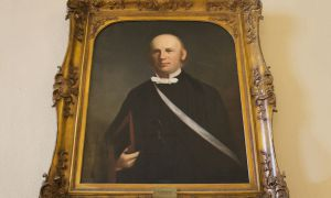 A portrait of Queen's fifth principal, William Leitch, hangs in Wallace Hall.