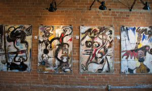 A line of Sylla's paintings at the Studio 22 gallery.