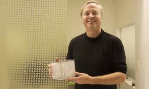 Roel Vertegaal, the director of the Human Media Lab, holds up one of the ShapeDrones.