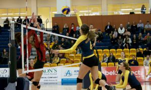 Shannon Neville strikes a serve at a home matchup earlier this season.