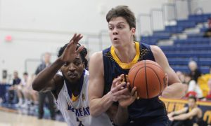 Ryall Stroud (right) drives past a Lakehead defender on Saturday night.