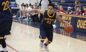 Mark Paclibar carries the ball upcourt. He picked up five defensive rebounds in Friday's loss.