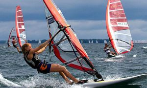 Mew competes in a windsurfing event.
