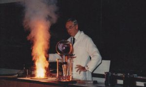 K.E. Russell conducting a demonstration for his students during one of his chemistry classes.