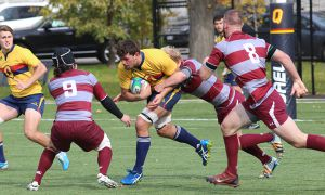 Lucas Rumball (centre) has been an integral part of the Gaels for the last four years.