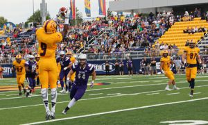 Receiver Chris Osei-Kusi makes a catch during Saturday's game