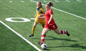 Jenny Wolever battling against a Carleton Ravens defender earlier this season at Richardson Stadium.
