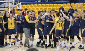 Men's volleyball celebrates their 3-0 win against Trent.