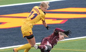 Tara Bartram battles the Gee Gees defender for the ball.