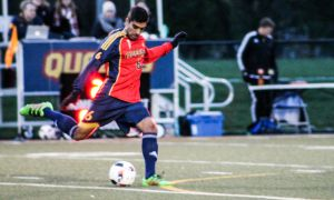 Rohan Sarna making a cross in the Gaels' last home game.