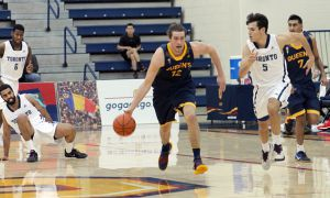 Tanner Graham scored 14 points, 11 rebounds and added four blocks in the 75-71 loss to U of T.
