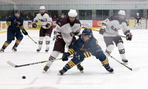 Queen's battles for the puck against St. Mary's.