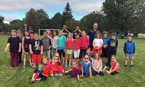 Queen's football players visited local schools during their bye week.