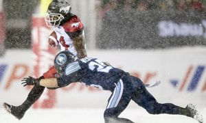 Matt Webster making a tackle at the 105 Grey Cup.