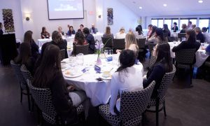 A crowd in the University Club listened to speakers at Saturday morning's event.