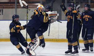 Stephanie Pascal (goalie) rejoices with teammates after Gaels' 2-1 win over Nipissing.