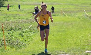 Brogan MacDougall won her first university race at the Queen's Invitational this weekend.