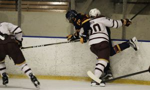 Forward Jaden Lindo takes a hit in the second period.