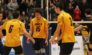Fourth-year Zac Hutcheson (middle) celebrates after making a crucial play in the second set.
