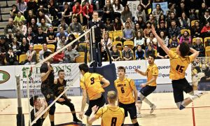 Fourth-year Zac Hutcheson flies towards the ball in front of a packed home crowd.