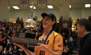 Zac Hutcheson holding the Forsyth Cup after his team won the OUA gold medal game last weekend.