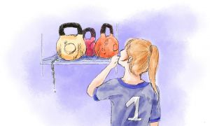 female athlete looking at weights