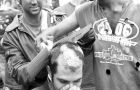 Engineering frosh receive their traditional haircuts in Agnes Benidickson Park.