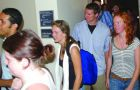 Student residents of Aberdeen Street exit a private meeting held yesterday by Principal Hitchcock, who expressed her concerns about the unsanctioned Homecoming street party.