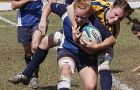 Queen's flanker Shauna Geerts brings down Toronto fly-half Hannah Ehrhardt Saturday.