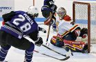 Queen's goaltender Brady Morrison makes a save on Western right winger Salvatore Peralta Saturday night in London.