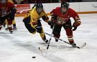 Queen's forward Kelsey Thomson (72) battles Guelph's Dayna Kanis for the puck Saturday.