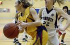 Gaels' forward Alaina Porter tries to get by Nicki Schutz of the Varsity Blues Saturday night at Bartlett Gym.