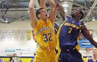 Gaels' forward Bernard Burgesson tries to block Laurentian's Paul Kovacs Friday.