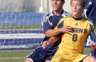 Gaels' midfielder Michael Arnold fights off a Varsity Blues defender in Sunday's scoreless draw in Toronto.