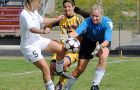 "Queen's midfielder Cathleen Brennan tries to take advantage of Toronto goalkeeper Mary-Anne Barnes against the University of Toronto Varsity Blues during the Gaels' 0-0 draw at Richardson Stadium on Sunday. For full game story, visit us on the web at queensjournal.ca and click on ""Sports""."