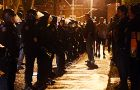 Riot police line Aberdeen Street north of William Street at about midnight.