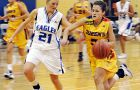 Gaels' guard Kendra Walker-Roche blows past an Eagles defender during Saturday's overtime nailbiter win.