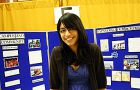 Rebecca Gill, ArtSci '10, mans QPID's booth at the Study and Work Abroad Fair in Grant Hall yesterday.